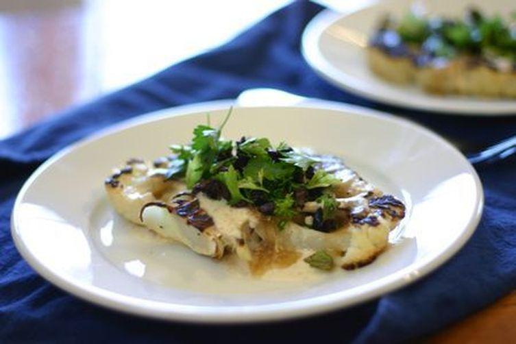 Roasted Cauliflower Steaks with Date Syrup, Tahini, and Kalamata Olives