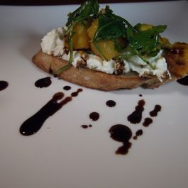 Ricotta crostini with butternut squash, arugula, and balsamic drizzle.