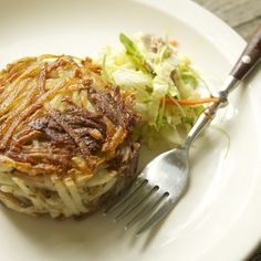 Potato and Pork Confit Cakes with Wilted Napa Cabbage and Cress Slaw