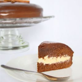 Honey Cake with White Brigadeiro Filling Covered with Chocolate Ganache