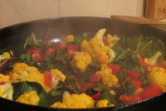 Greens with garlic, tomatoes and wine