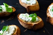 Ramped Up Crostini with Ricotta and Pea Shoots