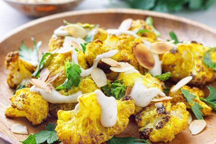 Roasted cauliflower with tahini and almonds