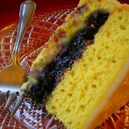 Monet's Mango Surprise: Lemon Pecan Spice Cake filled with Blueberries and Mango