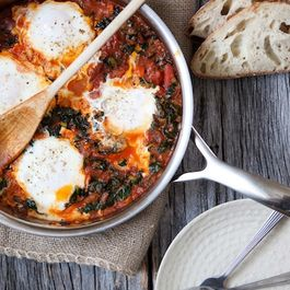 Eggs in a Wintry Kale and Tomato Sauce