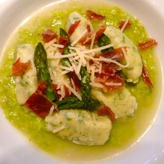 Homemade Goat Milk Ricotta Gnudi on Asparagus Puree in a Parmesan Brodo