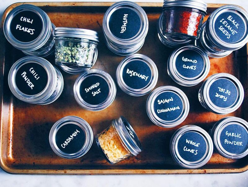 Black chalk paint + chalk = easy spice organization.
