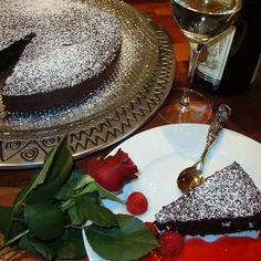 Decadent Flourless Chocolate Cake with Raspberry Coulis