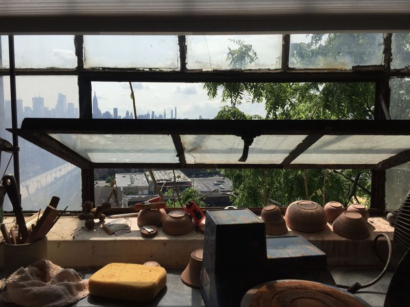 The distant New York skyline out of Jono Pandolfi's New Jersey studio