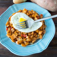 Sweet Potato Hash topped with a Sunny Side Up Egg