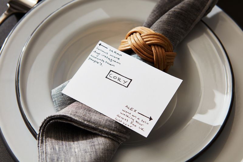 Give your guests a fun fact about their neighbors for an easy conversation starter.