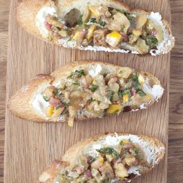 Goat cheese crostini with Meyer lemon, green olive and fig relish