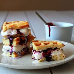 Waffle ice cream sandwich with blueberry sauce