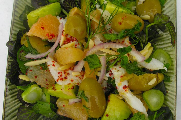 Ceviche with pink grapefruit and green olives