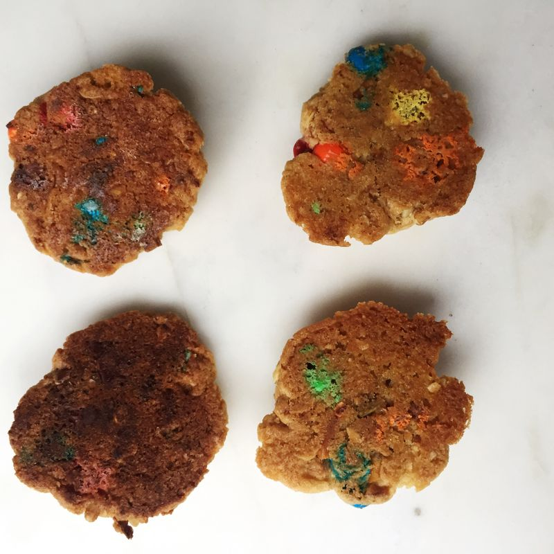 The cookies baked on parchment (left) were darker than those baked on Silpat (right): It's most evident in the M&M bottoms.