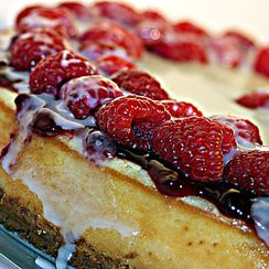 White Chocolate Cheesecake with Raspberry Sauce, Fresh Raspberries and White Chocolate Glaze