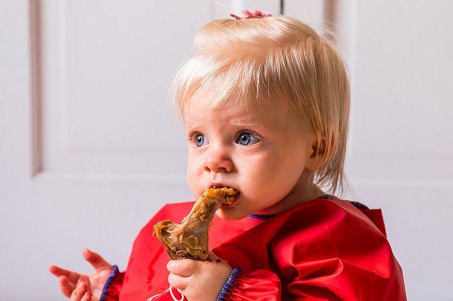 Clara eating braised chicken