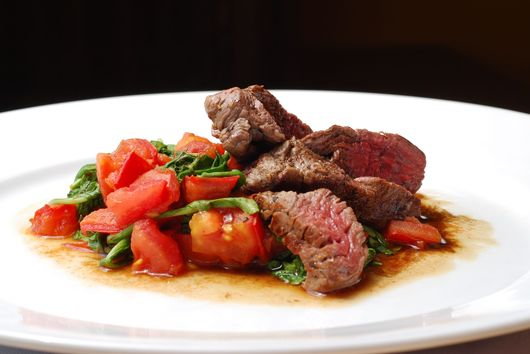 Filet of Beef with Caramelized Onions, Tomato and Arugula