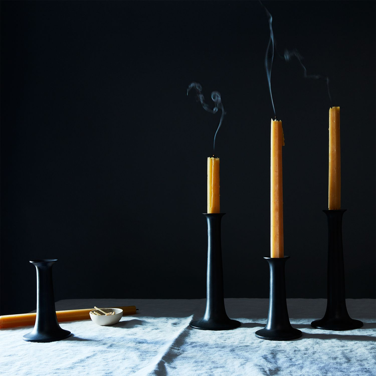 modern black candlesticks (set of ) on food -