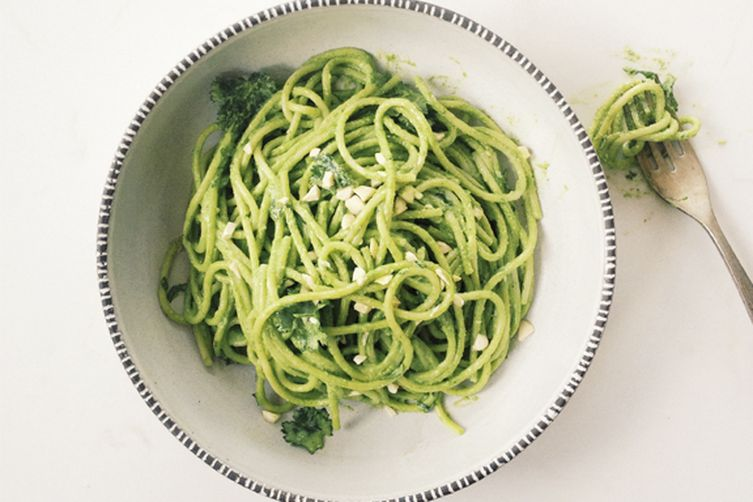 Spaghetti with Swiss chard, cilantro, and cashew pesto and goat cheese