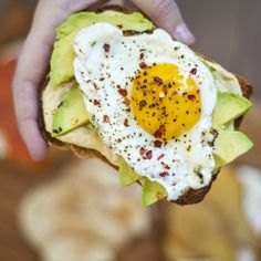 Toast with Hummus,  Avocado, Fried Egg & Chili Flakes