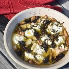 Baked Goat Cheese with Garlic, Olives and Herbs