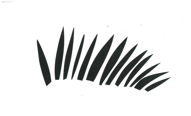 Dramatic eyebrow, overturned eyelash, or half a palm branch—you decide.