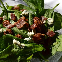 Spinach salad with candied bacon and spiced pecans