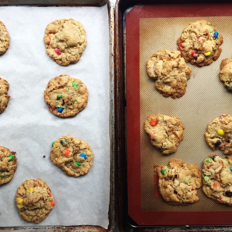 The parchment paper cookies held their shapes better (but only slightly).