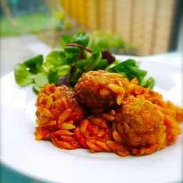 Deeply-fragrant pork and fennel meatballs with oven-baked orzo