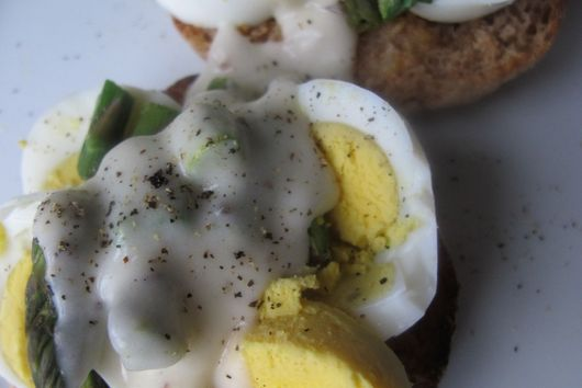 Chopped Eggs on English Muffins with Asparagus and Cheese Sauce