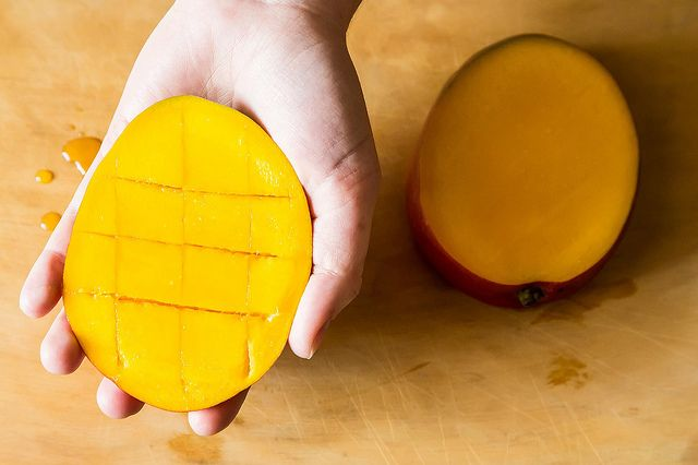 How to slice a mango of the mango making the cuts as close together as you want your eventual pieces to be then switch to widthwise youre making a crosshatch pattern ccuart Choice Image