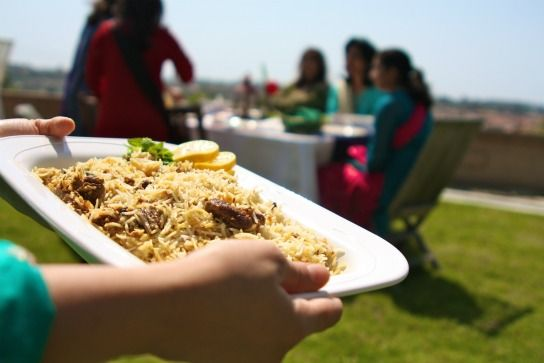 Serving biryani