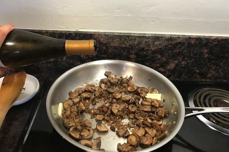 Mushroom Toast with goat cheese, parmesan, shallot, garlic & herbs