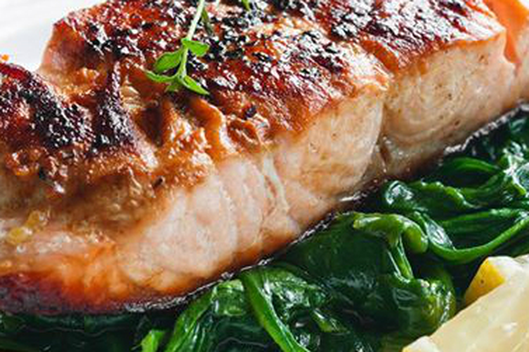 SALMON WITH THYME ON BED OF SPINACH - avocadoglobal.com