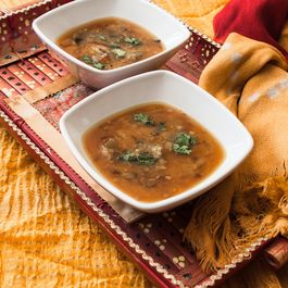 Refreshing lentil soup with green mango
