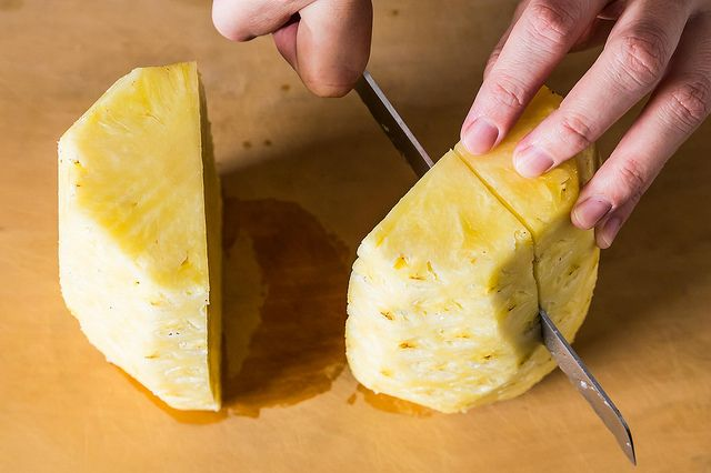 Slicing pineapple