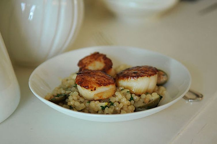Israeli Couscous with Roasted Lemons & Capers topped with Seared Scallops & a Lemon Creme Fraiche Drizzle