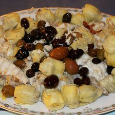Oven-baked Angler with Artichoke Hearts and Spicy Olives