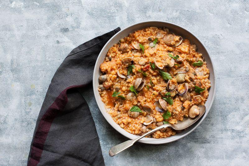 Fregola sarda stars in this classic Sardinian clam stew.