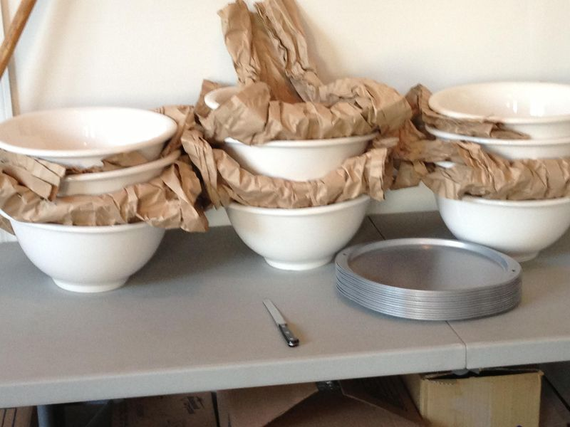 The ceramic bowls (and pizza-tray covers) Homa likes to use for making yogurt.