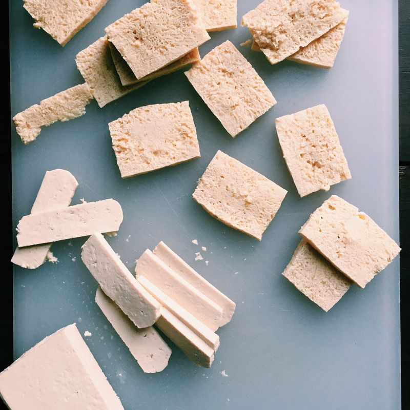 Frozen tofu (top) as compared to pressed tofu (bottom).