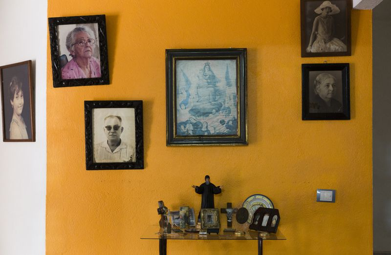 Photos of Mimy Aguilera Contreras's complex family tree on display at her home in Villahermosa.