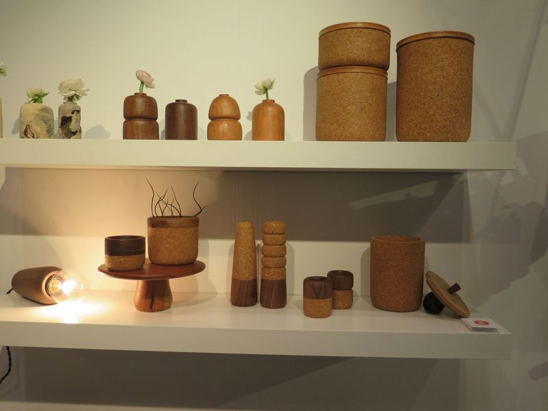 A hanging socket, candlesticks, storage containers, and a coffee canister—all in cork at Melanie Abrantes.