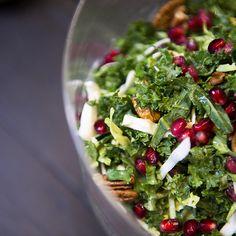 SuperGreens Salad with Pomegranate, Walnuts, and Hummus Dressing