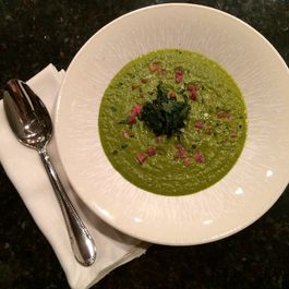 Warm Kale bisque with apple and pancetta - Topped with Crispy kale chips