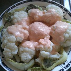 Steamed Cauliflower with Low-Fat Cheddar-Garlic Sauce