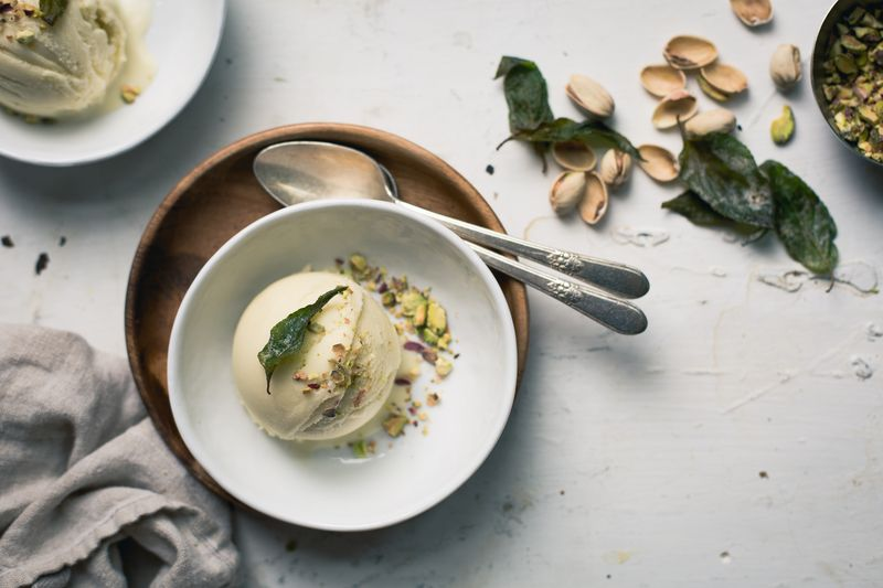 Coconut ice cream with pineapple sage and crushed pistachios.