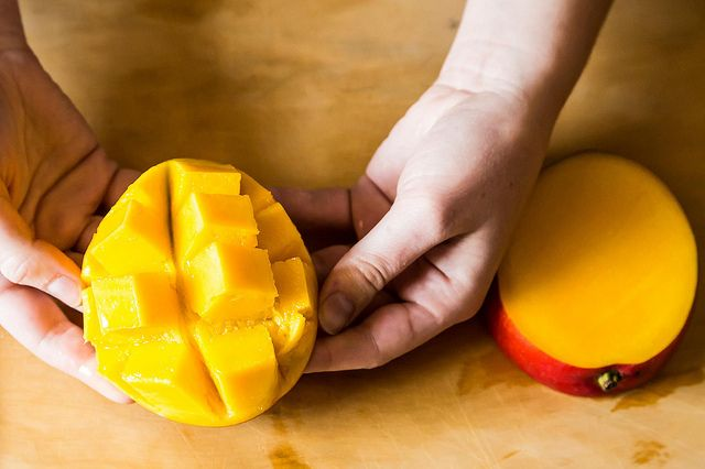 How to slice a mango pressing up from the skin side of the mango invert the flesh perfect cubes will magically appear ccuart Choice Image
