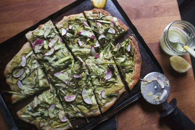 Shaved Asparagus, Radish, and Cashew Pea cream Pizza